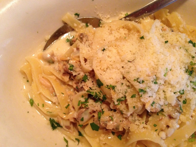 fettuccine with white clam sauce and cheese on top