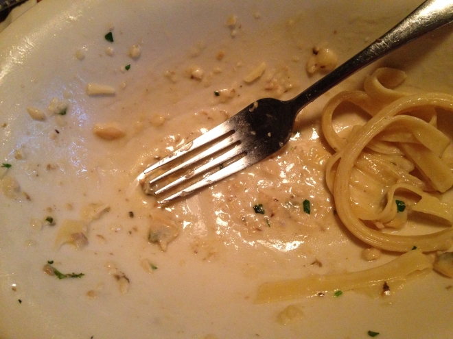 empty dish of fettuccine with white clam sauce