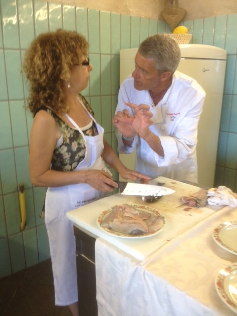 Our chef explaining the fish filleting process