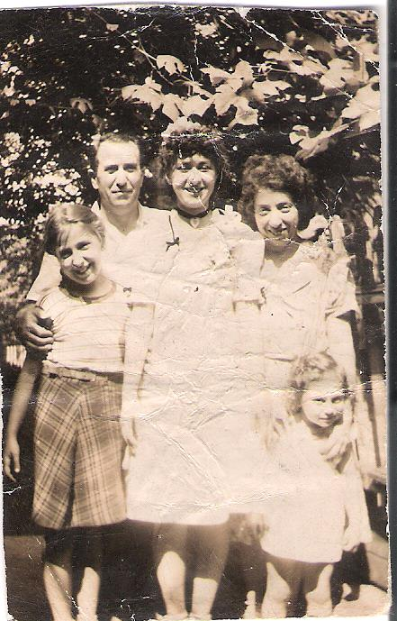 My mom in center, with her parents, my aunt lily at left, and we can't remember who the baby is
