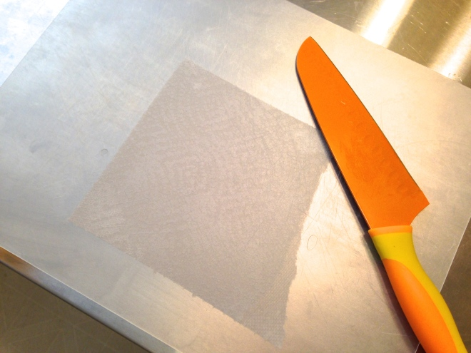 cutting board with damp paper towel