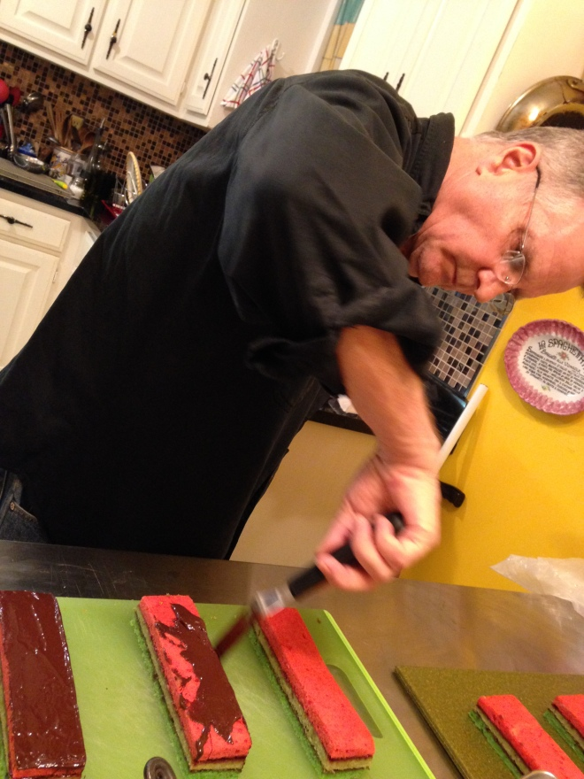 Duane applying the chocolate for rainbow cookies