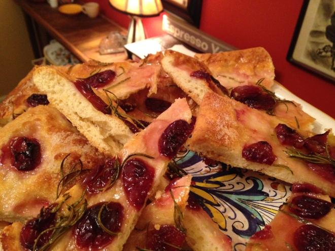 grape pizza cut into pieces