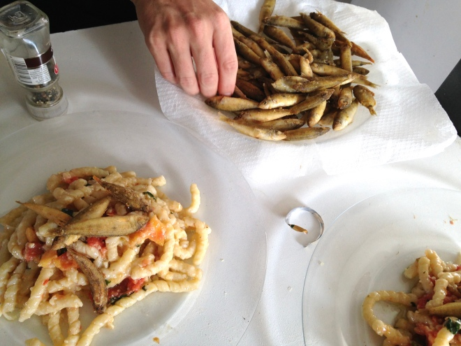 tiny fried fish with pasta and almond pesto